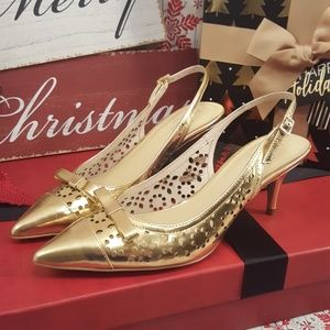 Kate Spade New York gold slingback heels.